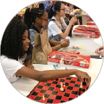 Photo of students playing chess and other games